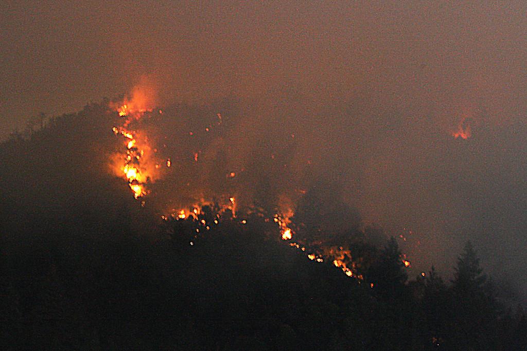 . A Santa Cruz Mountains ridge top burns off Bear Creek Road in the Santa Cruz Mountains in the pre-dawn hours Tuesday. (Dan  Coyro -- Santa Cruz Sentinel)