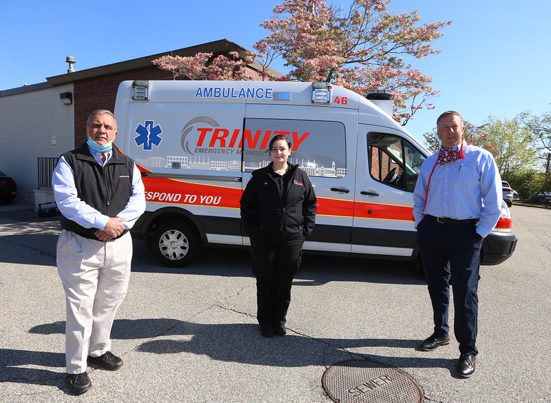 """Sharon Kuenzler of Trinity EMS with president John Chemaly, left, and director of business development & marketing Chris Dick. Kuenzler recoverd from what was considered a """"mild"""" case of COVID-19 that she said was """"the sickest I've ever been in my life."""" (SUN/Julia Malakie)"""