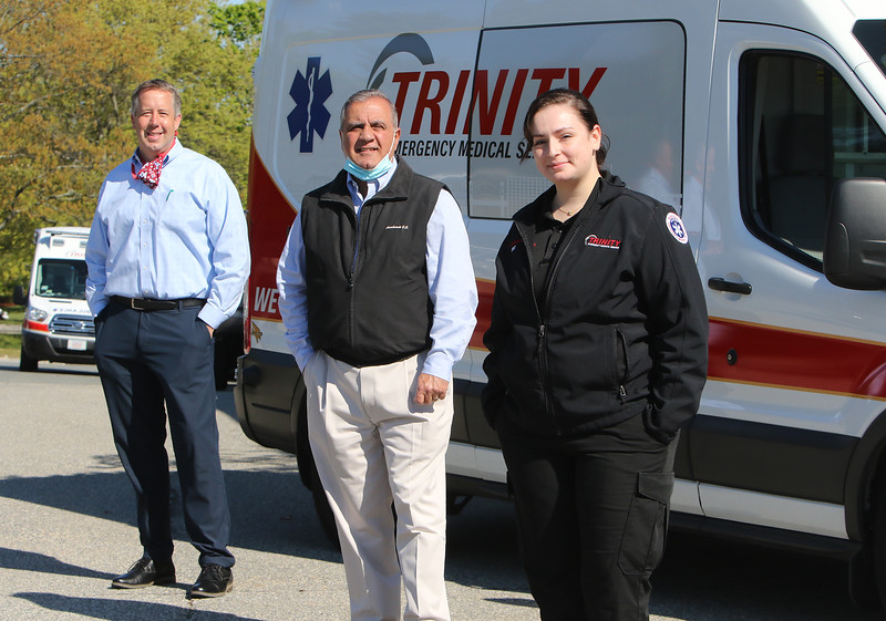 "Right to left: Sharon Kuenzler of Trinity EMS with president John Chemaly and director of business development & marketing Chris Dick. Kuenzler recoverd from what was considered a ""mild"" case of COVID-19 that she said was ""the sickest I've ever been in my life."" (SUN/Julia Malakie)"