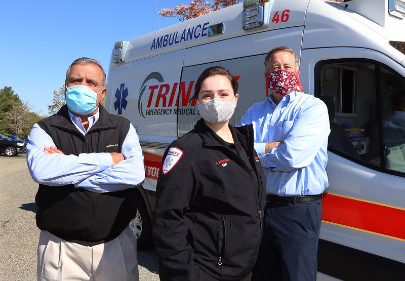 "Sharon Kuenzler of Trinity EMS with president John Chemaly, left, and director of business development & marketing Chris Dick. Kuenzler recoverd from what was considered a ""mild"" case of COVID-19 that she said was ""the sickest I've ever been in my life."" (SUN/Julia Malakie)"