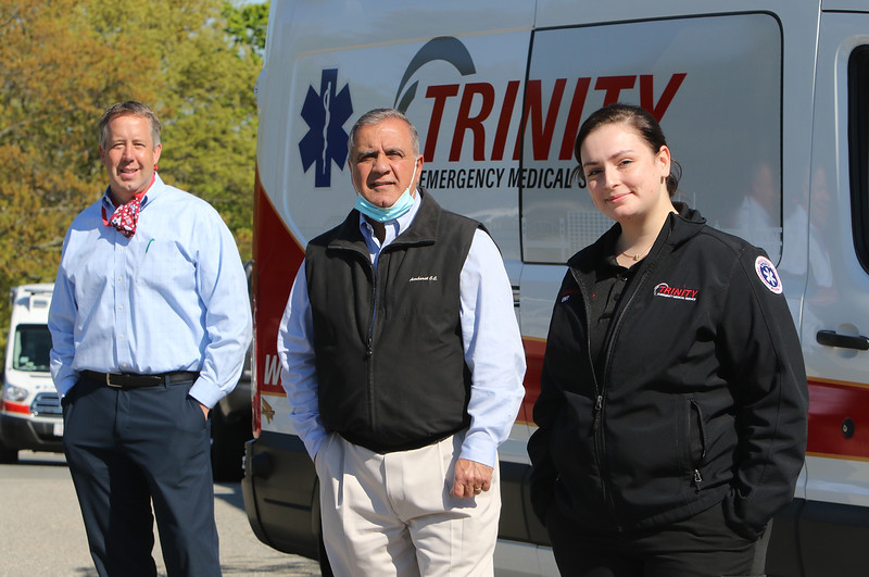 """Right to left: Sharon Kuenzler of Trinity EMS with president John Chemaly and director of business development & marketing Chris Dick. Kuenzler recoverd from what was considered a """"mild"""" case of COVID-19 that she said was """"the sickest I've ever been in my life."""" (SUN/Julia Malakie)"""