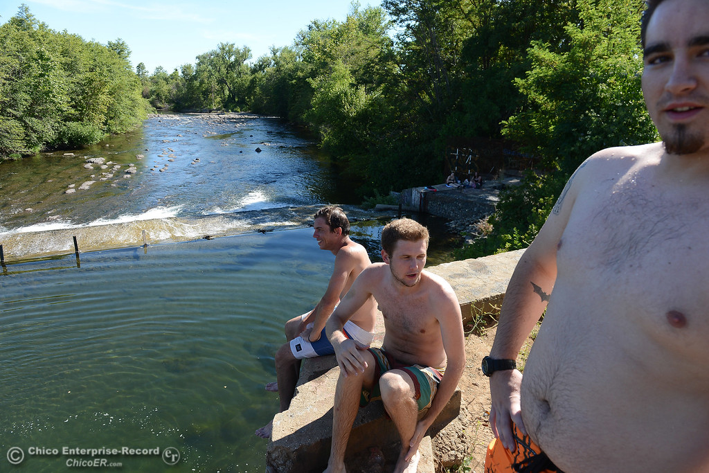 . Left to right, Zac Vanasen, of Chico, Kevin Myers, of Chico,  and Tim Trulin, of Corning, relax at Butte Creek as people beat the heat Friday, June 16, 2017, in the Butte Creek Ecological Preservein Chico, California. (Dan Reidel -- Enterprise-Record)