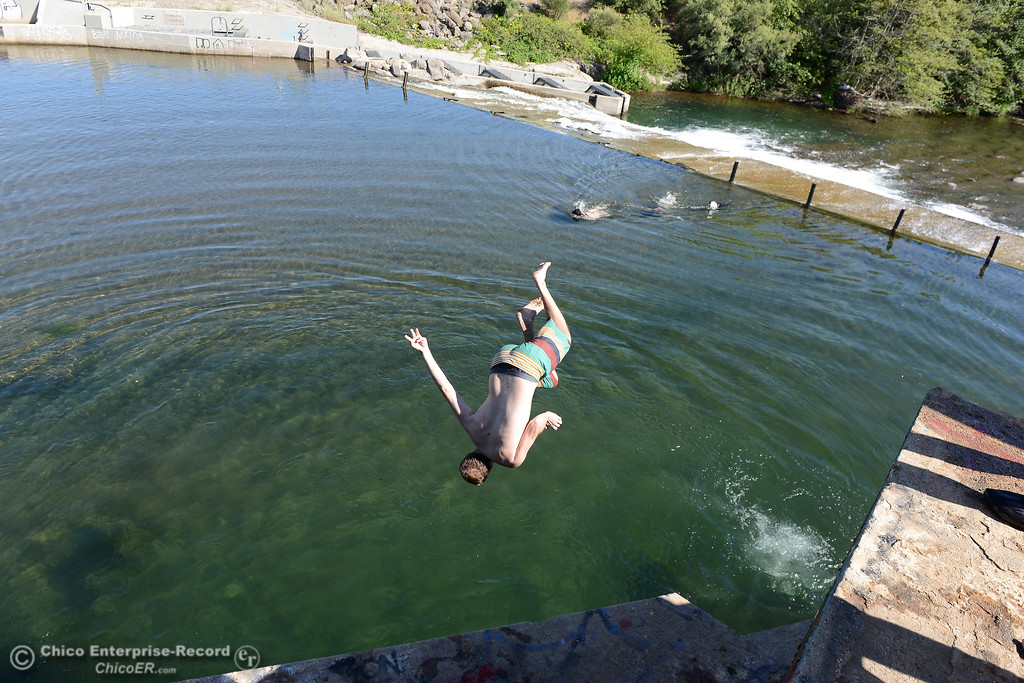 . Kevin Myers, of Chico, flips and twists as he leaps Friday, June 16, 2017, into Butte Creek in the Butte Creek Ecological Preservein Chico, California. (Dan Reidel -- Enterprise-Record)
