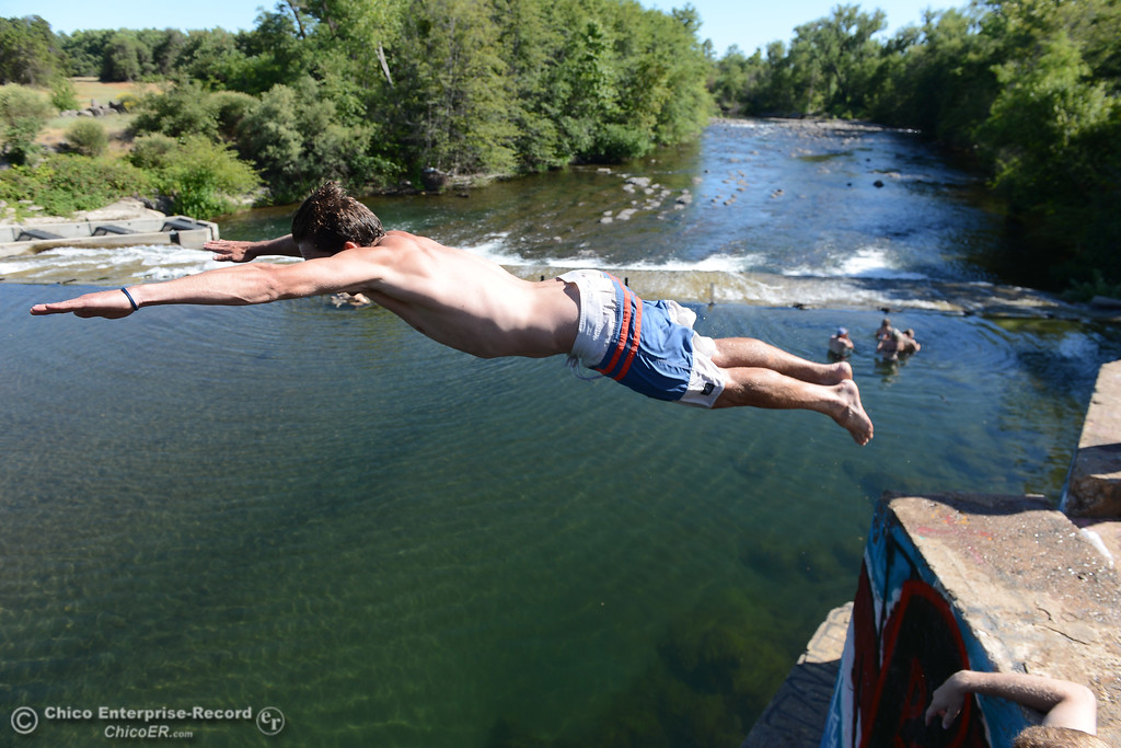 . Chico State student Zac Vanasen dives into Butte Creek as people beat the heat Friday, June 16, 2017, in the Butte Creek Ecological Preserve in Chico, California. (Dan Reidel -- Enterprise-Record)