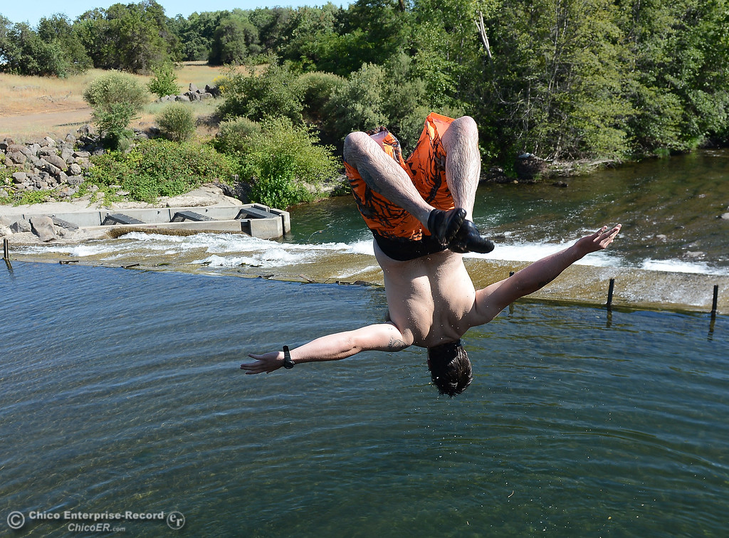 . Tim Trulin, of Corning, flips into the water as people beat the heat Friday, June 16, 2017, in the Butte Creek Ecological Preservein Chico, California. (Dan Reidel -- Enterprise-Record)