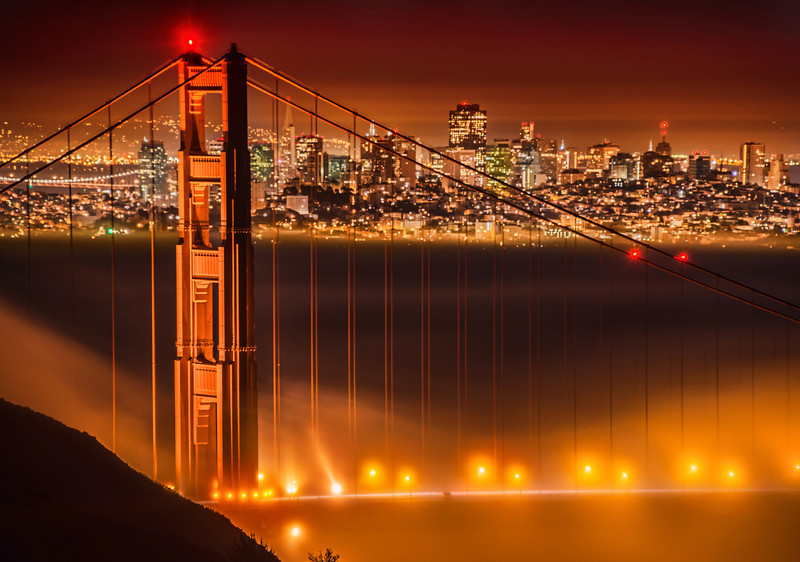 Magical Fog in San Francisco over the Golden Gate Bridge I recently drove across the bridge and up this little mountain road to try to find this shot. I started driving up a road I knew well, but it was closed. Closed! So I parked, got out my tripod, and hiked about a mile up this hill to get to this spot. It was a very cool night, but there was some strange inversion happening. Almost anywhere I stood on the side of the hill was a stead hotel-room 72-degrees. And there was zero wind. It was a perfect night, and just when I arrived, the fog really started pouring over the bridge, so I set up for this shot...- Trey RatcliffClick here to read the rest of this post at the Stuck in Customs blog.