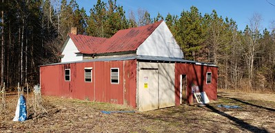 Old home converted to storage building on Tract 2