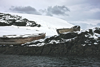 "100 year old ""water boats"" left from expeditions in sailing ships.  Enterprise ""harbor"", Antarctica"