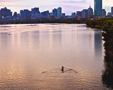 Rowers at dawn on the Charles River in Cambridge, Massachusetts