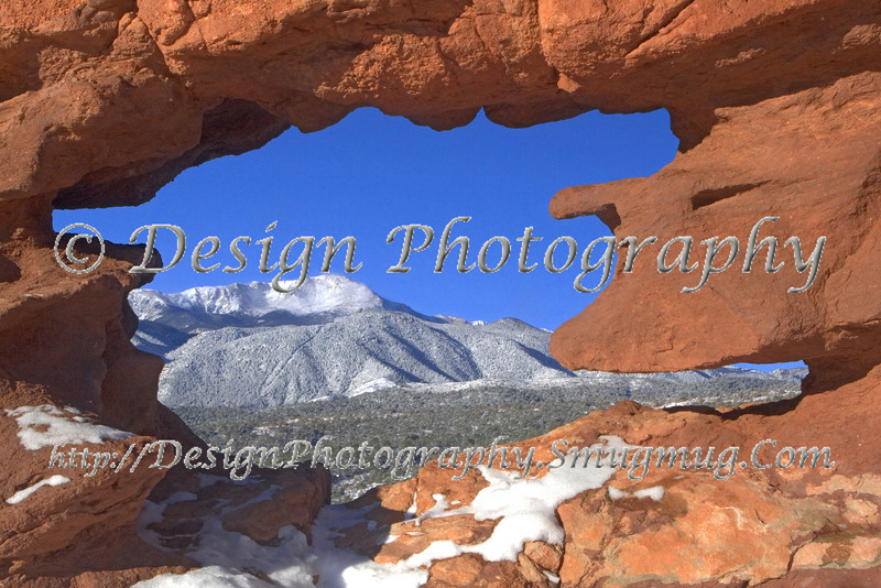 Pikes Peak seen through hole at Garden of the Gods Park, Colorado Springs, Colorado