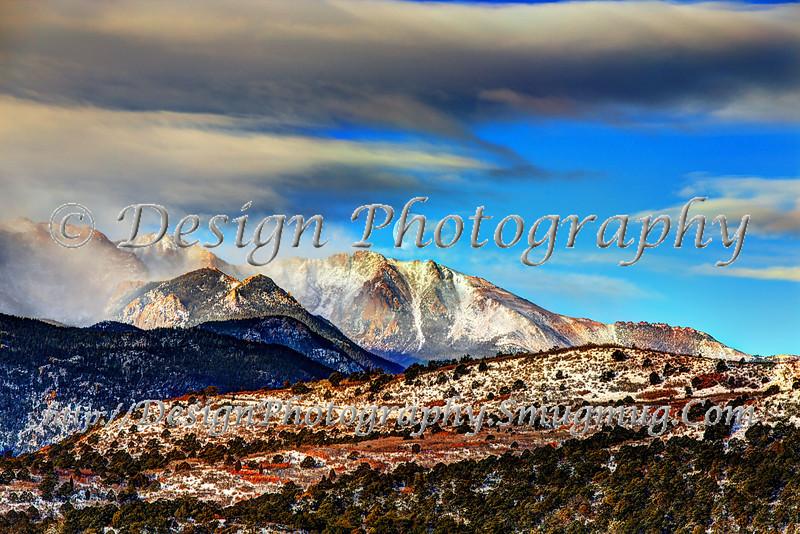 Moon setting behind the Rocky Mountains, Colorado Springs, Colorado