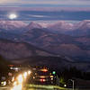Supermoon setting over the mountains in Colorado