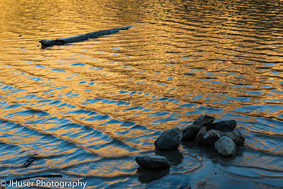 Sunset colors reflected on water