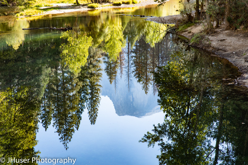 Reflections of Half Dome in water