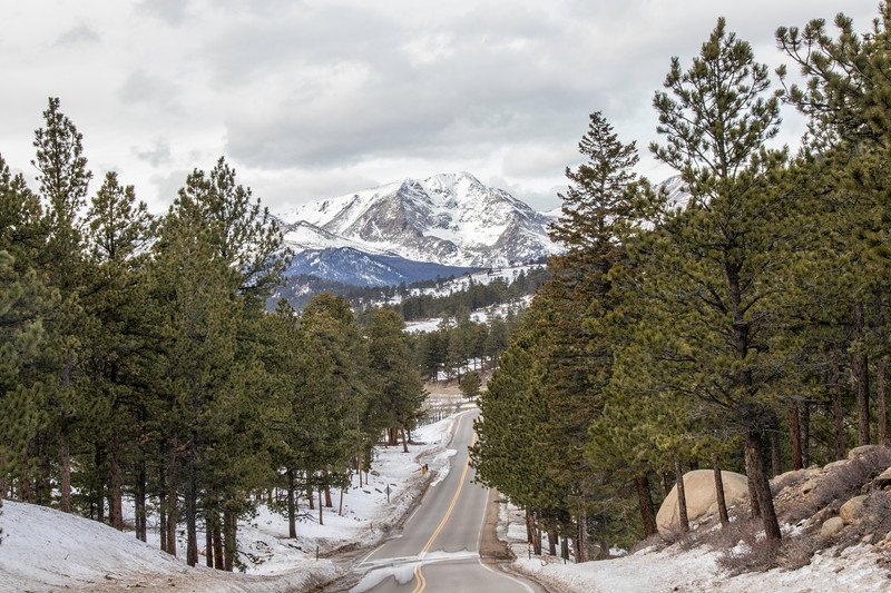 A road leading to the snowy mountains in Rocky Mountain National Park
