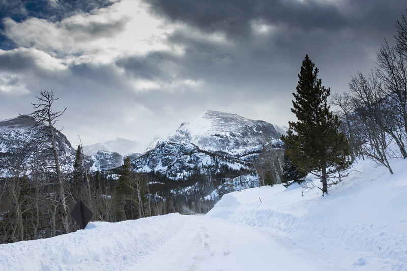 Deep snow along the road leading to the mountains in Colorado