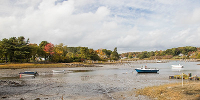 Autumn color and low tide with fishing boats aground