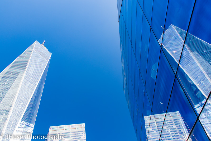 One World Trade building reflecting in the glass of the 911 Museum in New York City