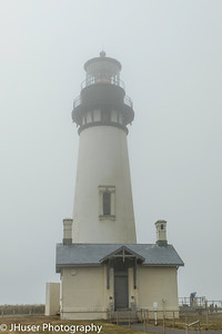 Closeup view of Yaquina Head Lighthouse in the fog