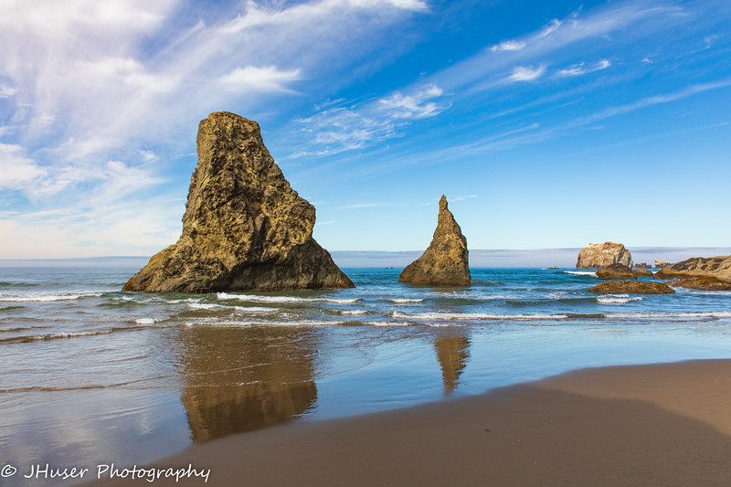 Sea stack reflections on Bandon beach in Oregon