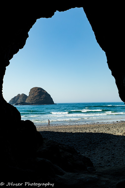 Looking out a cave onto an Oregon beach