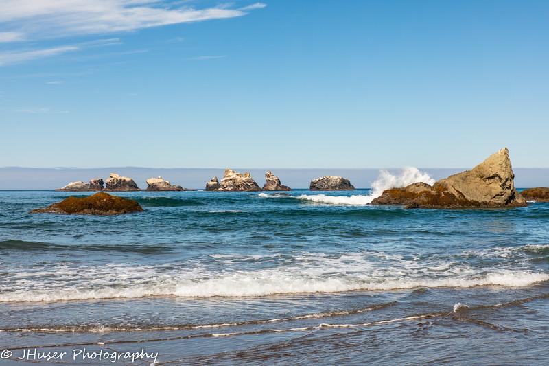 Waves breaking on sea stacks in Oregon