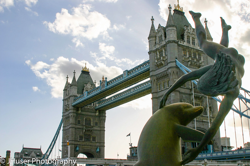 Girl with a dolphin fountain and Tower Bridge