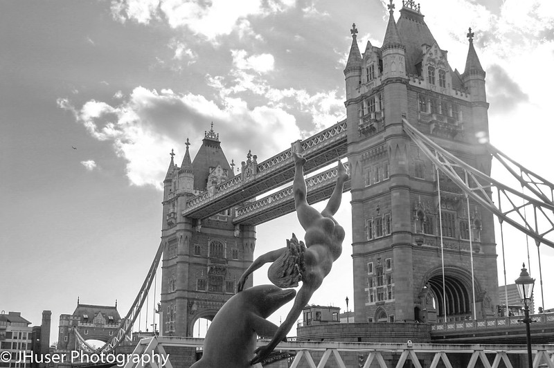 Girl with a dolphin fountain and Tower Bridge in black and white