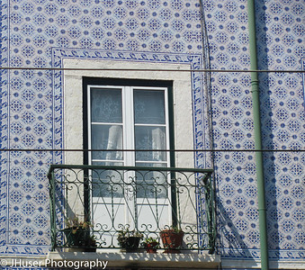 Colorful blue tile on an apartment building in Lisbon