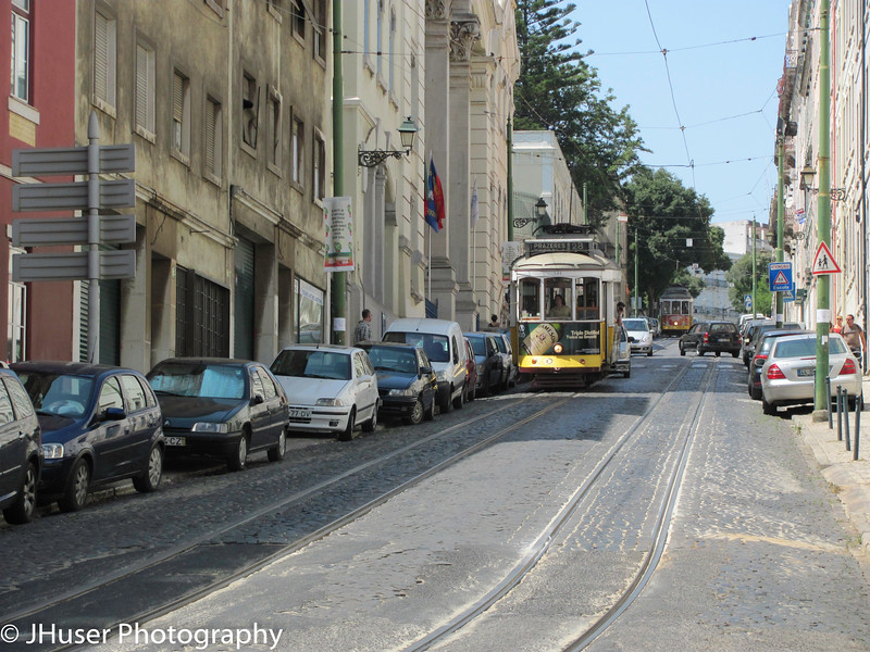 Electric cable car and narrow road in the Alfama area of Lisbon