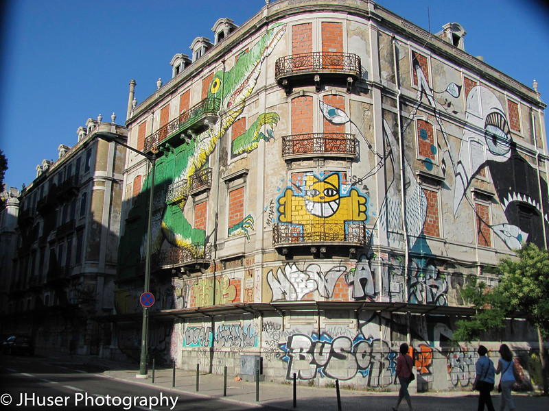 Graffiti and artwork painted on empty building in Lisbon