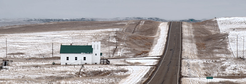 The Trotters Evangelical Church building is one of two buildings still standing at what used to be Trotters, North Dakota. Now it's just a crossroads on Highway 16 about 254 miles north of Beach, and about 4 miles east of the Montana line in the heart of the National Grasslands.