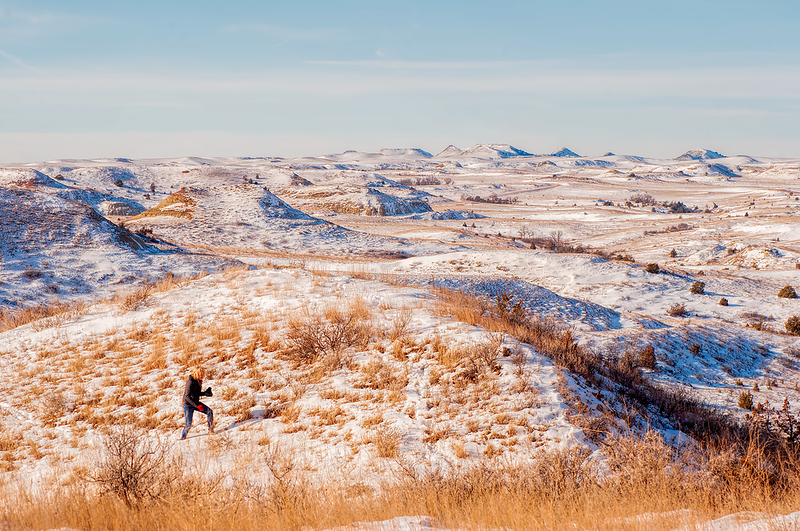 "Hiking across the sugar-coated hilltops of the Badlands.<br /> <br /> You can add this to your collection of Badlands images. Just click the ""buy"" button to start browsing and buying."