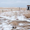On what would be the western edge of Trotters, North Dakota -- if the town were more than a ghost -- this pair of his-and-her outhouses sit neglected behind the Evangelical Church building