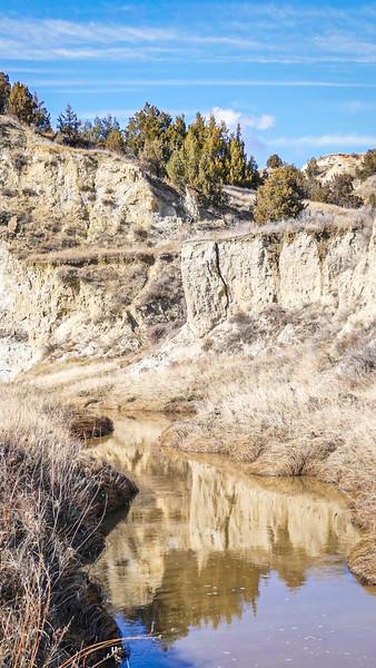 Spring Reflections at Magpie Creek, North Dakota Badlands