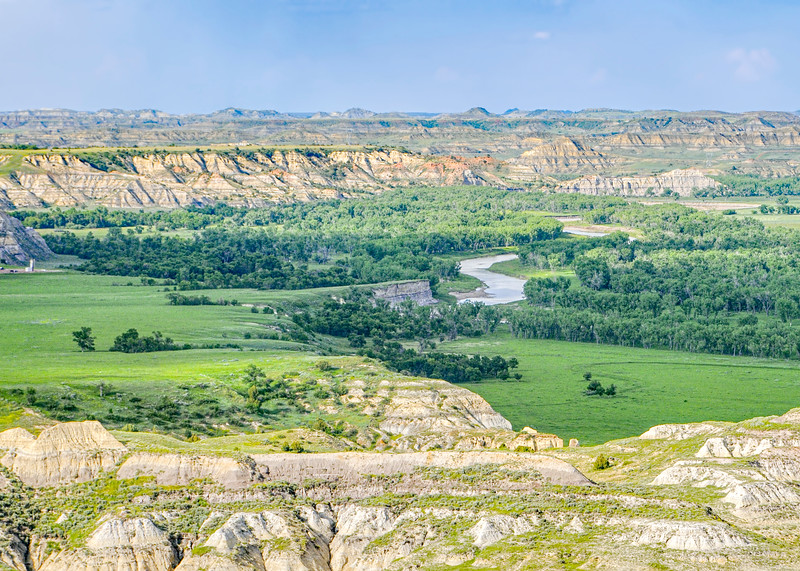 """From the top of Chimney Butte, the Little Missouri River flows north to Medora.<br /> <br /> You can own this image as wall decor (canvas wrap,metal print, matte print, etc) or a keepsake such as a coffee mug, refrigerator magnet or mousepad.  Just click """"buy"""" to browse the products you can own."""