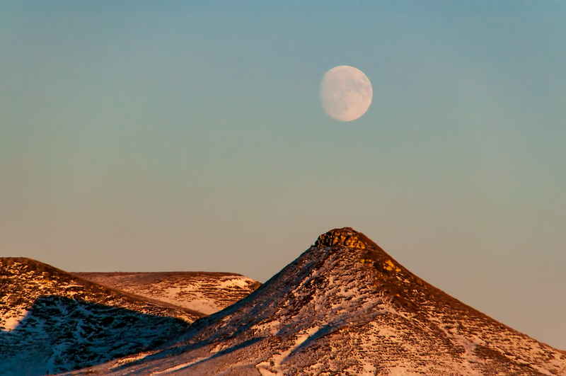 """Full moon, beaver moon over hills in southern Stark County, ND.<br /> <br /> You can own this image as wall decor, mouse pad, coffee cup or other product.  Just click """"buy"""" to browse the products you can buy here."""