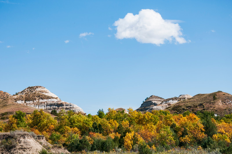 "From Magpie Creek, an autumn day is good for hiking the North Dakota Badlands.<br /> <br /> You can collect this image as wall decor, coffee mug or other product.  Just click ""buy"" to browse and shop."