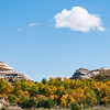 """From Magpie Creek, an autumn day is good for hiking the North Dakota Badlands.<br /> <br /> You can collect this image as wall decor, coffee mug or other product.  Just click """"buy"""" to browse and shop."""
