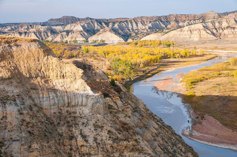 """There's not much water in the Little Missouri River in the fall. The North Dakota Badlands force the river to meander through western North Dakota from the south to the north.<br /> <br /> You can own this image as wall decor or other products. Browse after you click the """"buy"""" button to see how inexpensive it is to own an image of the North Dakota Badlands."""