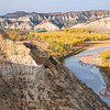 "There's not much water in the Little Missouri River in the fall. The North Dakota Badlands force the river to meander through western North Dakota from the south to the north.<br /> <br /> You can own this image as wall decor or other products. Browse after you click the ""buy"" button to see how inexpensive it is to own an image of the North Dakota Badlands."