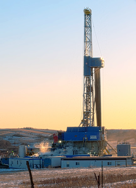 Drilling never stops. Just because the day is ending and the golden glow of sunset is settling in, it doesn't mean work stops. Work on this rig on the Ft. Berthold Indian Reservation continues.