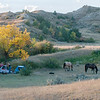 "Horseback riders on the Maah Daah Hey set up camp. <br /> <br /> <br /> You can own this image as a wall decor, coffee mug, mouse pad or other product.  Just click the ""buy"" button to go shopping."