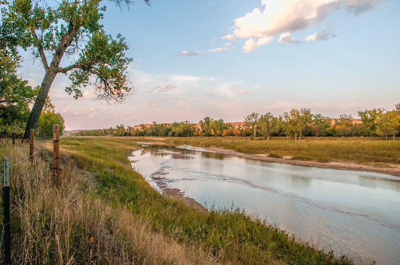 "The golden hour on the Little Missouri River in front of Theodore Roosevelt's Elkhorn Ranch.<br /> <br /> <br /> You can own this image as a wall decor, coffee mug, mouse pad or other product.  Just click the ""buy"" button to go shopping."