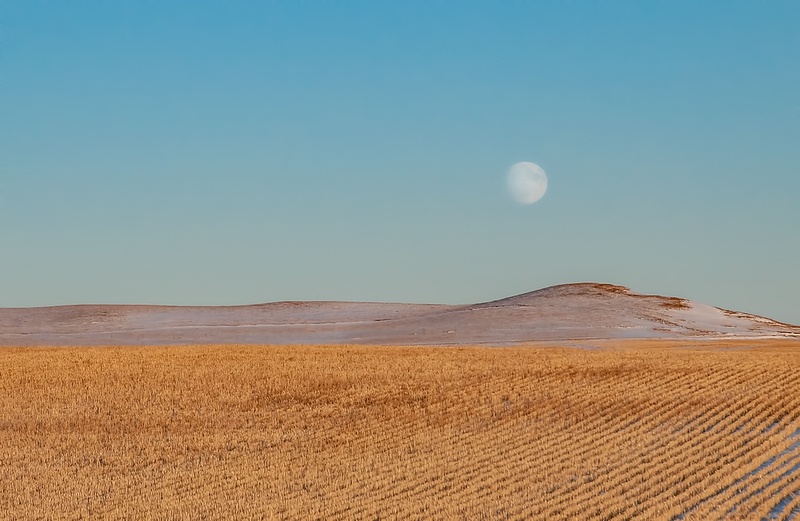 """Nearly full moon over hills in southern Stark County stubble field.<br /> <br /> You can own this image as wall decor, mouse pad, coffee cup or other product.  Just click """"buy"""" to browse the products you can buy here."""