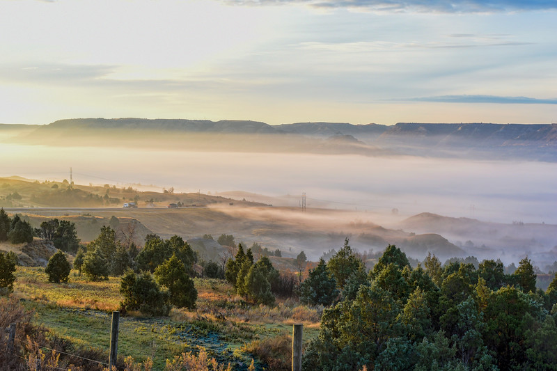 "Fog lies low over the Little Missouri River south of Watford City.<br /> <br /> You can own this image as wall decor, mouse pad, coffee cup or other product.  Just click ""buy"" to browse the products you can buy here."