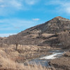 The spring snow melt pushed streams out of their banks, leaving muddy flatlands nearby as the stream continues to shink.  Here, a stream carries snow melt down the hill to the Little Missouri River