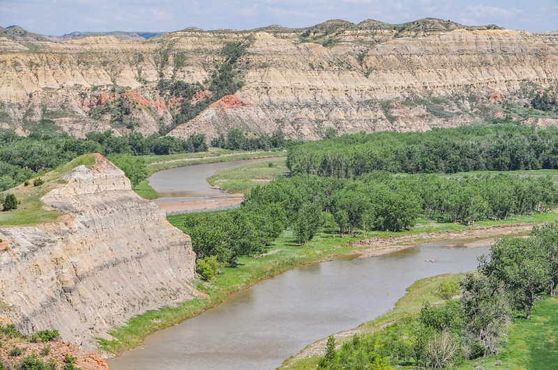 """Flowing north, the Little Missouri River makes a sharp bend east, then wraps back around west.<br /> <br /> You can own this image. To browse the wall decor or keepsakes, just click the """"buy"""" button."""