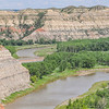 "Flowing north, the Little Missouri River makes a sharp bend east, then wraps back around west.<br /> <br /> You can own this image. To browse the wall decor or keepsakes, just click the ""buy"" button."