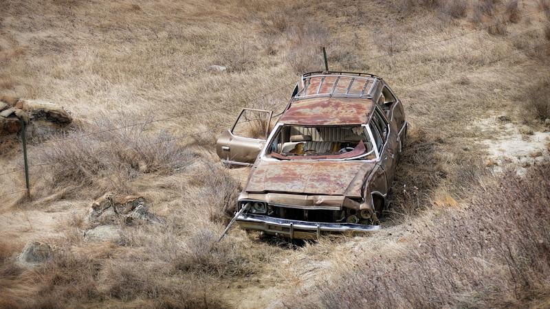 wrecked Oldsmobile station wagon